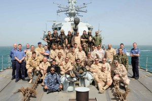 Students with members of the Ship's Company.