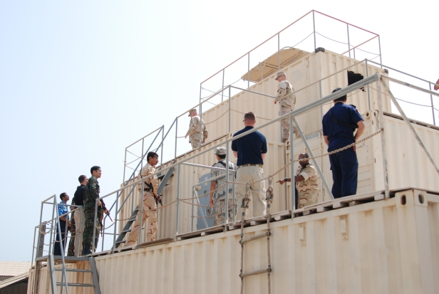 Members of CMF conduct boarding on ship simultor