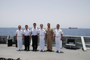 Gulf of Aden, May 7 – (L to R) CAPT Fan Zaijun (COS, CTF 526); SLTC Thng Chee Meng (COS, CTF 151); RADM Harris Chan (CCTF 151); CDRE Han Xiaohu (CCTF 526); CDR Adan Cruz (CO USS Mason); CAPT Fu Xiaoliang (CO CNS Wenzhou).  With convoy of merchant vessels CTF 526 was escorting in the background.  (RSN Photo/Released)