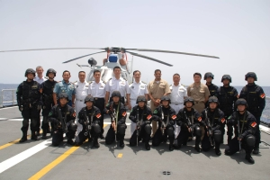 Gulf of Aden, May 7 – (L to R) ME3 Ng Cheng Boon (Battle Watch Assistant, CTF 151); LTC Utomo H. Krisno (Dy N3, CTF 151); CAPT Fan Zaijun (COS, CTF 526); SLTC Thng Chee Meng (COS, CTF 151); RADM Harris Chan (CCTF 151); CDRE Han Xiaohu (CCTF 526); CDR Adan Cruz (CO USS Mason); CAPT Fu Xiaoliang (CO CNS Wenzhou); MAJ Kim Hosup (Battle Watch Captain, CTF 151).  Together with the PLA Navy's Special Operations Force on board CNS Wenzhou.  (RSN Photo/Released)