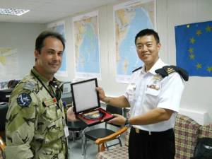 DJIBOUTI (April 27, 2011) RADM Harris Chan (CCTF 151) presenting a CTF 151 plaque to CDR Raul Risso (Officer in Command of EUNAVFOR ASA). (RSN Photo/Released)