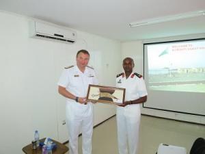 Commodore Tarrant Commander CTF150 meeting Colonel Cher Commander of the Djiboution Navy