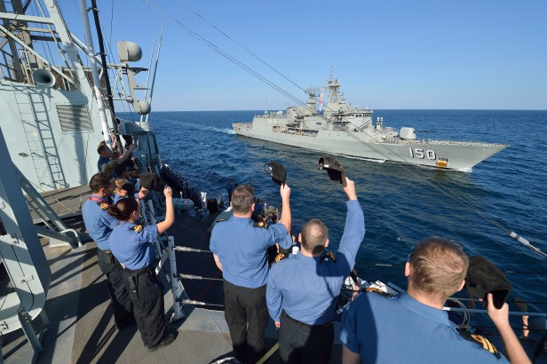 Members of Her Majesty's Canadian Ship (HMCS) Regina bid farewell to Her Majesty's Australian Ship (HMAS) Anzac as she prepares to leave Combined Task Force (CTF) 150 and head back to Australia, on January 04, 2012, after working for four months with HMCS REGINA in the Arabian Sea region. HMCS REGINA is presently participating in Operation ARTEMIS.