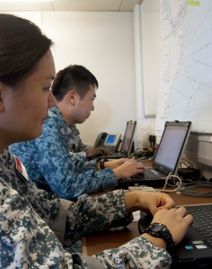 Capt Michelle Chai and Maj Dennis Lim in Fort Victoria's Air Operations Room