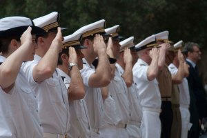 Members of CTF 150's French battlestaff salute at the Change of Command ceremony prior to sailing from Bahrain.