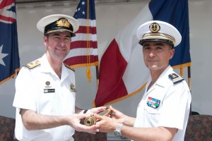 Commodore McHardie hands over the symbolic telescope to Captain Martinet to signify the Change of Command.
