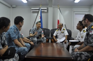 Rear Admiral Giam Hock Soon, Commander of CTF-151, speaks with Japanese Captain Akira Katoh during a visit to the P3 DAPE headquarters in Djibouti