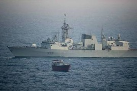 HMCS Toronto positions herself during the boarding of the suspect dhow, later found to be carrying 500 Kg of heroin.