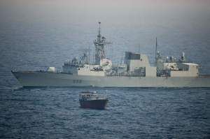 HMCS Toronto keeps watch over the suspect vessel