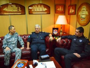 CTF 151's Rear Admiral Giam Hock Koon (L) meets the Commander of NATO's Task Force 508, Italy's Rear Admiral Antonio Natale, (Centre) and Portuguese Commodore Jorge Palma, head of the EU's Task Force 465, aboard ITS San Marco