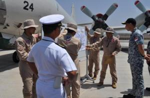 CTF-151 Rear Adm. Giam Hock Koon, CTF-151 commander receives a brief from P3 DAPE members.