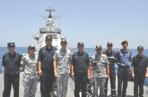 Members of the Singapore-led multinational command staff visit Chinese warship CNS Harbin in the Gulf of Aden.