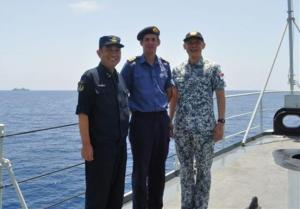 Rear Admiral Yuan Yubai, Commander, ETG 112 (left), RFA First Officer Ian Coombes (centre) and Rear Admiral  Giam Hock Koon, Commander, CTF 151 (right) with CTF 151 flagship Fort Victoria in the background during their visit onboard CNS Harbin in the Gulf of Aden.