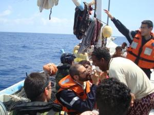 FS Somme's doctor provides medical assistance to the crew of a Yemeni dhow.