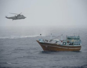 250miles SE of Mogadishu the Sea King of HMCS Toronto holds position over the suspected drugs dhow