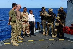 HMS Kent's Royal Marines Boarding Team demonstrates board and search tactics to Colonel Ali Saleen of the Yemen Navy and Lieutenant Colonel Saalih Muhamed Alhumaymi of the Yemen Marines