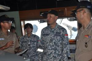Rear Admiral Giam Hock Koon tours the bridge aboard ROK Munmu the Great