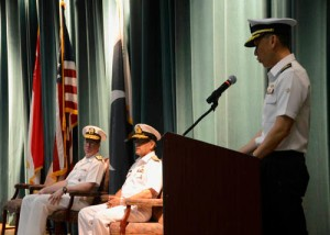 Rear Admiral Giam Hock Koon speaks at the CTF 151 Change of Command Ceremony