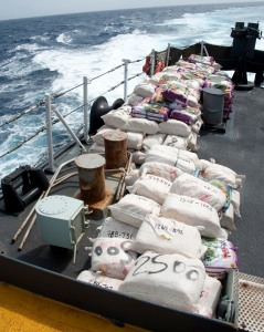 Bales of hashish are stacked on the quarterdeck of Her Majesty's Canadian Ship (HMCS) TORONTO in preparation for disposal