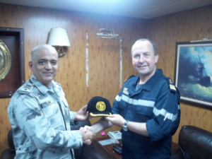 Commodore Muhammad Ihsan Qadir SI (M) (left) presents Captain Hervé Bléjean (right) with a CTF 151 ball cap following their meeting onboard TCG GÖKSU (F-497)