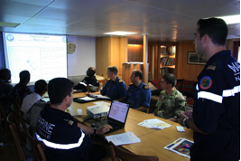 A planning meeting on board FS Somme with officers from HMS Kent, HMCS Toronto, FS Somme and Yemeni Coast Guard and Djibouti Navy. This meeting was focused on the attribution of the different zones of patrols.