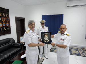 Commodore Muhammad Ihsan Qadir SI (M), receives a memento of his visit from Captain Amor Humaid Hamood Al Zakwani, the Southern Naval Area Commander for the Royal Navy of Oman, with CTF 151 Chief of Staff, Captain Khalid Pervez, watching.