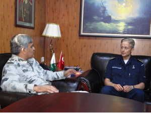 Commodore Muhammad Ihsan Qadir SI (M), with Commander Adriann Van De Sande of the Royal Netherlands Navy