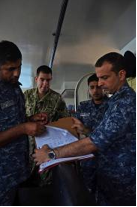 Commander Rashed Al Ameen (Right) coordinates the search for the casualty on the bridge of RBNS Al Jaberi