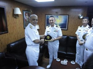 Commodore Muhammad Ihsan Qadir (left) presents Captain Tsutomu Iwasawa (right) with a CTF 151 ball cap following their meeting onboard TCG Goksu
