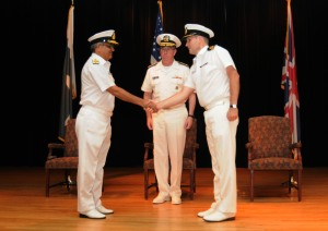 Vice Adm. John W. Miller, centre, commander, U.S. Naval Forces Central Command, U.S. 5th Fleet, Combined Maritime Forces, along with Commodore Muhammed Ihsan Qadir Pakistan Navy, (left) outgoing Commander of Combined Task Force (CTF) 151, and Commodore Jeremy Blunden Royal Navy, shake hands during the Change of Command ceremony. (U.S. Navy photo By Mass Communication Specialist 2nd Class Danielle Brandt)