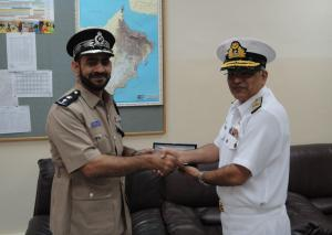 Commander, CTF 151 (on the right) presents the Acting Chief of the Omani Coast Guard with a gift following their meeting at the Coast Guard Headquarters in Muscat.