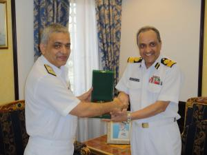 Commander, CTF 151 (left) presents a gift to the Acting Commander of the Royal Navy of Oman following their meeting