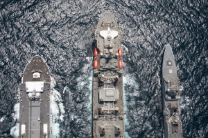 An aerial photo of RFA Fort Victoria as she conducts a dual RAS with Johan de Witt and HNoMS Fridjof Nansen.