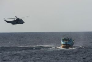HMCS Toronto's helicopter intercepts suspicious vessel. Photographed by Leading Seaman Dan Bard, Canadian Navy