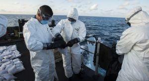 HMCS Toronto's crime scene investigation team collating the evidence and preparing it for disposal.  Photographed by Leading Seaman Dan Bard, Canadian Navy