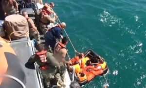 Coast Guardsmen from U.S. Coast Guard Cutter Maui (WPB 1304) rescue five Iranian mariners after they were found adrift in a life raft. (U.S. Navy video capture/Released)