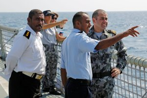 Yemeni and Australian officers exchanging knowledge on the local environment onboard Australian ship HMAS Melbourne in the Bab el Mandeb strait.