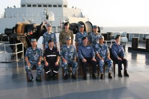 Combined Task Force 151 staff and Escort Task Group 999 staff on the foc'sle of PLA(N) Jinggangshan.