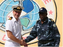 Commodore Jeremy Blunden, Royal Navy, Commander Combined Task Force (CTF) 151 meets with Colonel Abdourahmane Aden Cher, Commander of the Djiboutian Naval Force.