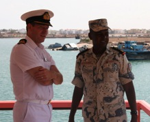 Commodore Jeremy Blunden, Royal Navy, Commander Combined Task Force (CTF) 151 meets with Lieutenant Colonel Wais O.Bogoreh, Commander of the Djibouti Coast Guard.