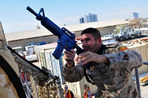 A service member from a Gulf Cooperation Council (GCC) nation prepares to advance during a visit, board, search and seizure (VBSS) seminar conducted by the U.S. Coast Guard Patrol Forces Southwest Asia (PATFORSWA) Maritime Engagement Team, Bahrain. PATFORSWA consists of Coast Guard personnel forward deployed to the U.S. Central Command area of responsibility in support of maritime security and maritime infrastructure protection operations. (U.S. Navy photo by Mass Communication Specialist 1st Class Felicito Rustique/Released)