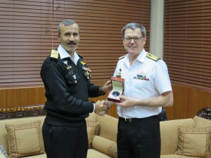 Commander Combined Task Force 150, Commodore Daryl Bates exchanges gifts with Director General Naval Intelligence, Rear Admiral Jamil Akhtar in Islamabad.
