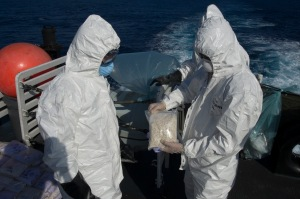 Her Majesty's Canadian Ship Toronto's disposal team destroys illicit narcotics seized on a trafficking vessel