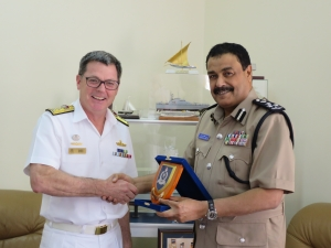 Commander Combined Task Force 150, Commodore Daryl Bates, Royal Australian Navy exchanges gifts with Brigadier Bader Khalfan Al Zadgali, Officer Commanding Coast Guard Headquarters, Royal Oman Police in Muscat, Oman.