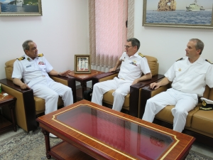 Commander Combined Task Force 150, Commodore Daryl Bates, Royal Australian Navy, Chief of Staff Combined Task Force 151, Commander Brian Ottesen, Royal Danish Navy and acting Commander of the Royal Navy of Oman, Commodore Rasheed Taj Moyd Al Raisi discuss maritime security operations in Muscat, Oman.