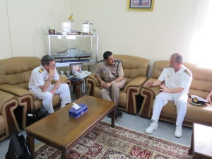 Commander Combined Task Force 150, Commodore Daryl Bates, Royal Australian Navy, Chief of Staff Combined Task Force 151, Commander Brian Ottesen, Royal Danish Navy and Officer Commanding Coast Guard Headquarters, Royal Oman Police, Brigadier Bader Khalfan Al Zadgali discuss maritime security operations in Muscat, Oman.
