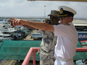 Commander Combined Task Force 150, Commodore Daryl Bates, Royal Australian Navy, and Commandant of the Djibouti Coast Guard, Lieutenant Colonel Wais Omar Bogoreh discuss maritime security in Djibouti.