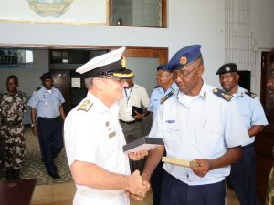 Commander Combined Task Force 150, Commodore Daryl Bates, Royal Australian Navy and Commander of the Navy of Mozambique, Rear Admiral Lazaro Henrique Lopes Menete exchange gifts in Maputo, Mozambique.