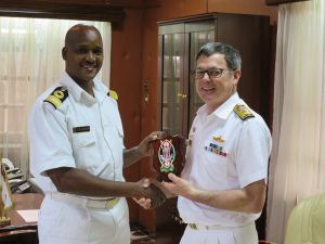 Commander Combined Task Force 150, Commodore Daryl Bates, Royal Australian Navy, and Deputy Commander of the Kenya Navy, Brigadier C. M.  Kahariri exchange gifts.