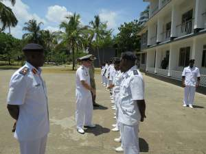 Commander Combined Task Force 150, Commodore Daryl Bates, Royal Australian Navy is greeted by Principal Staff Officers of the Tanzania Navy in Dar es Salaam.